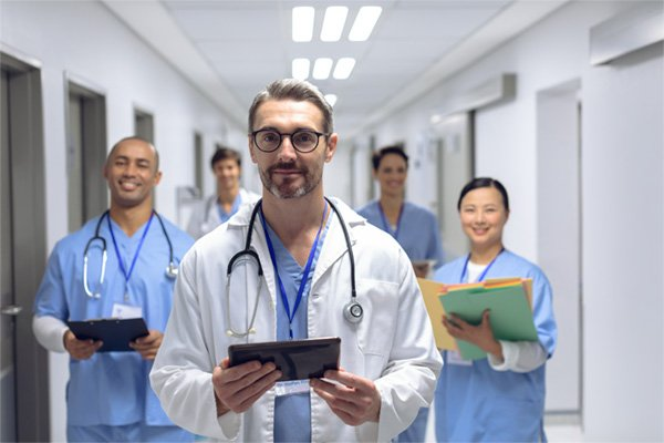 medical staff walking through hallway