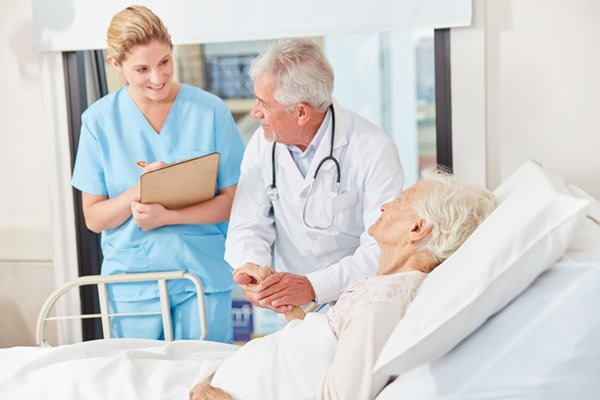 practitioner assistant and doctor with patient