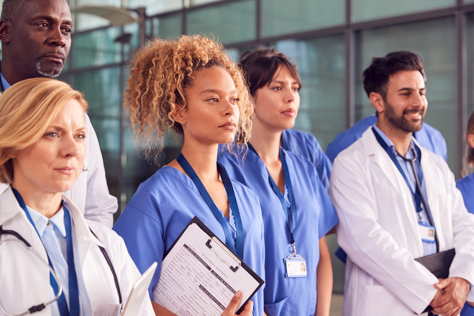 serious medical staff standing